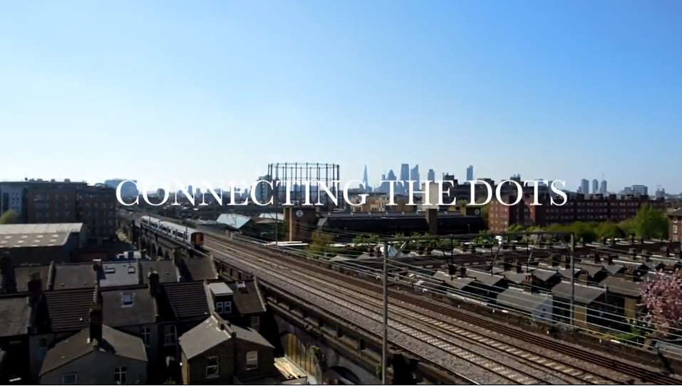 Image of rail way in front of a city, says connecting the dots