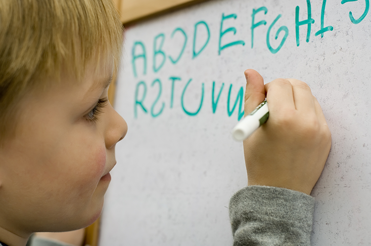 Image of child writing