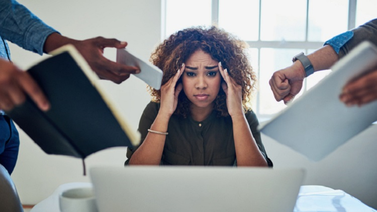 Image of a stressed out woman at work