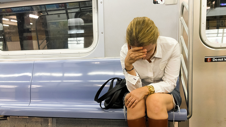 Image of a woman on a train having a panic attack