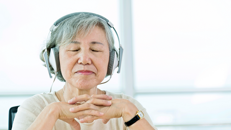 Image of elderly lady listening to headphones