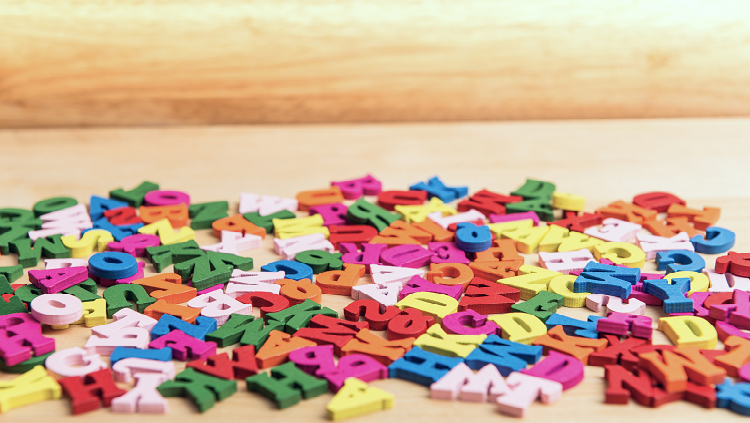 Photograph of multicolored letters on a table