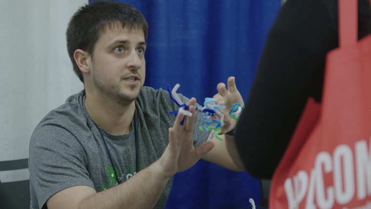 Neuroscientist Michael Caiola describes the parts of a neuron during an outreach event with teachers.
