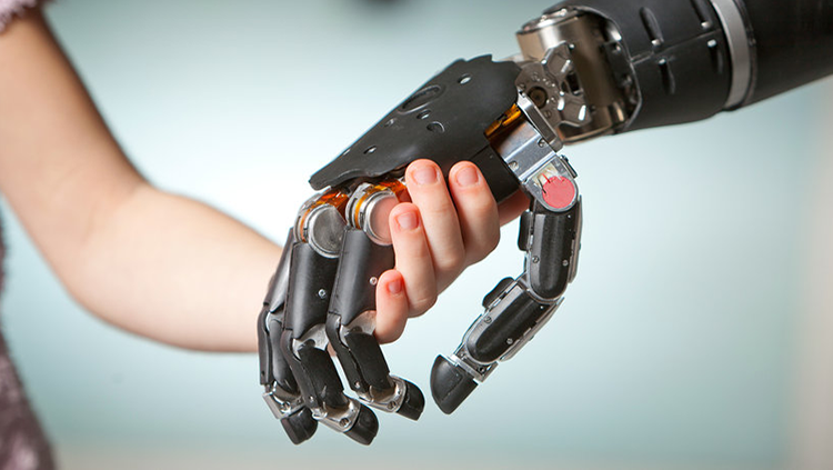 Image of a human hand holding a robotic hand