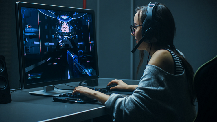 Photgraph of a woman sitting at a computer with a headset on