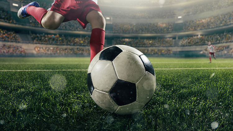 Image of a man kicking a soccer ball