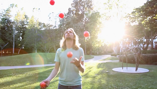 Man juggling five balls