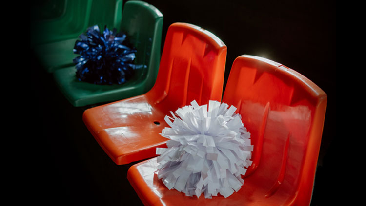 Empty seats with pom poms