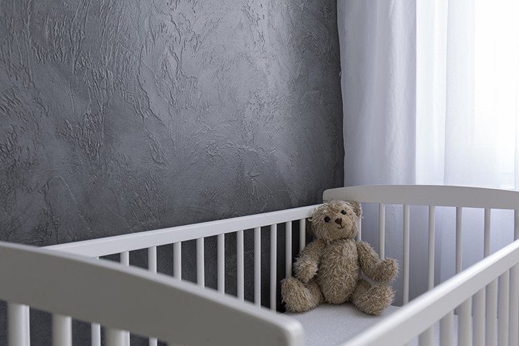 A teddy bear in a crib