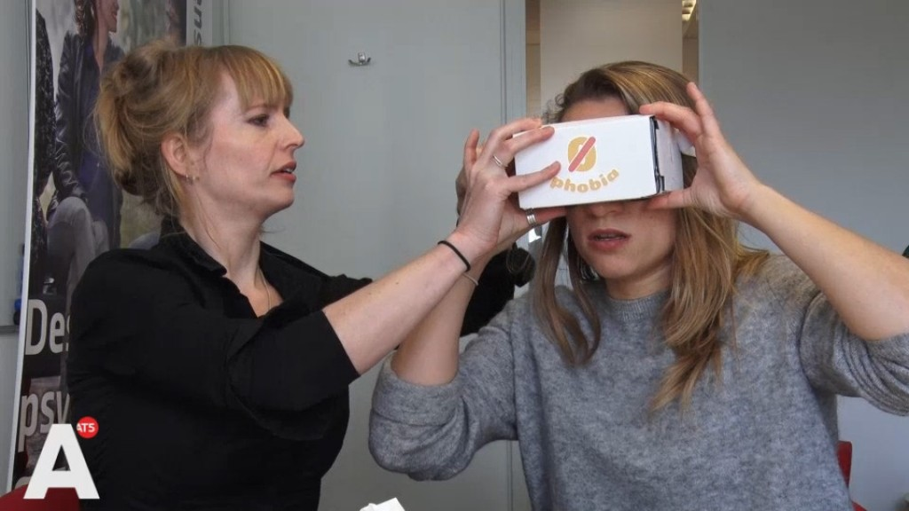 Woman looking through virtual reality goggles