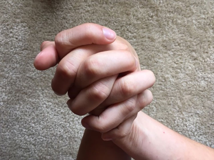 Hands laced together