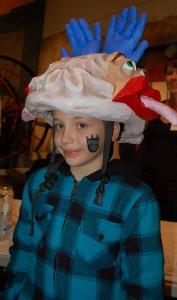 boy wearing brain hat