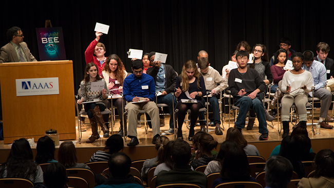 Students on stage during the Washington, DC Brain Bee held at AAAS on February 10, 2015. The regional Washington, DC Brain Bee shown above, move on to national competitions in 23 countries, and those winners move on to compete in the International Brain Bee