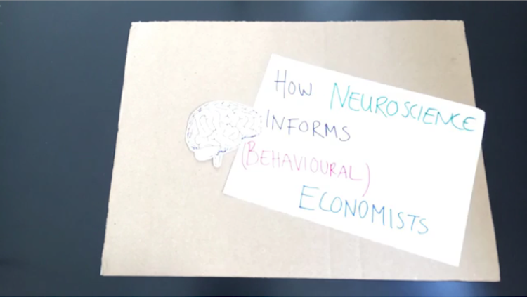 how neuroscience informs (behavioural) economists written in marker next to a cutout brain