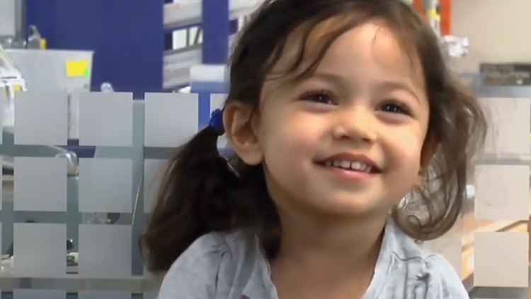 smiling girl in a lab
