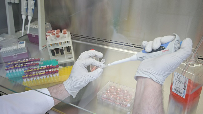 A man using a pipette