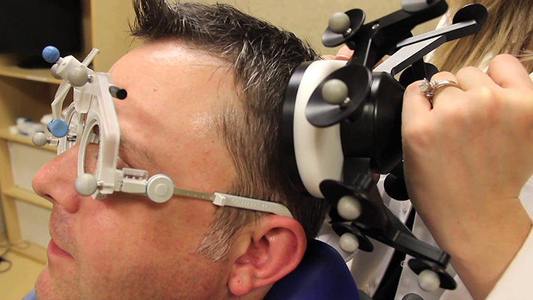 Image of man with a TMS machine on his head