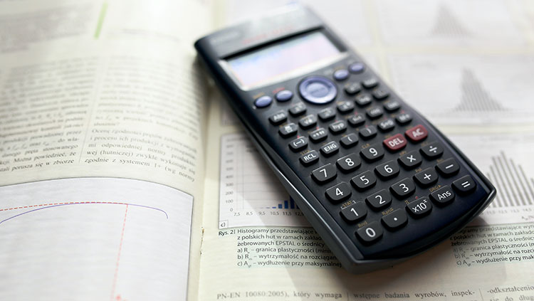 Photo of a scientific calculator on an open math textbook