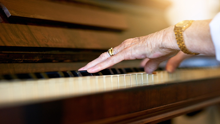 Shot of a senior woman playing the piano at home