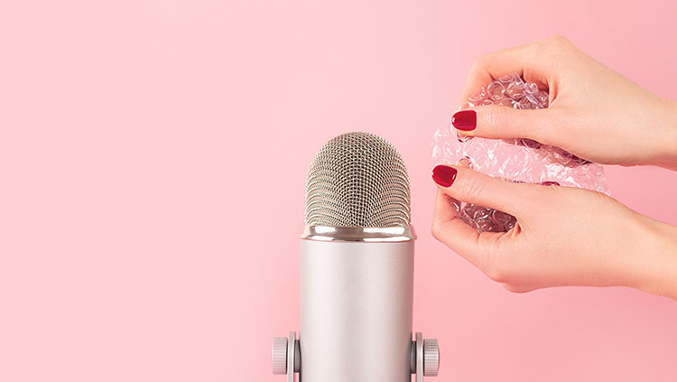 Hands holding bubble wrap near microphone