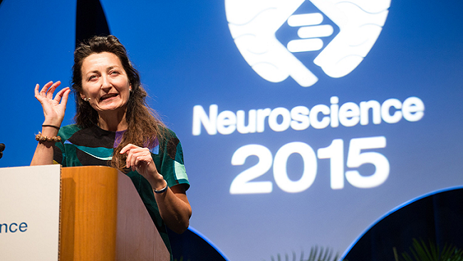 Photo of May-Britt Moser giving a Presidential Special Lecture at Neuroscience 2015, the annual meeting of the Society for Neuroscience.