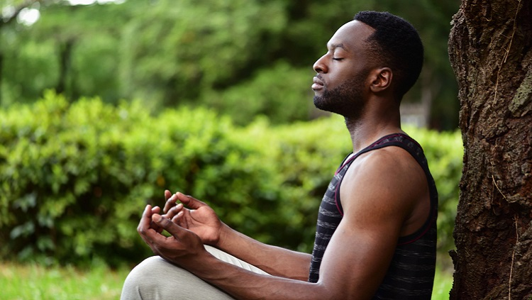 Photograph of a man meditating