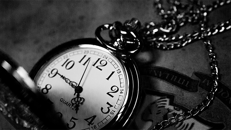 black and white photo of antique pocket watch