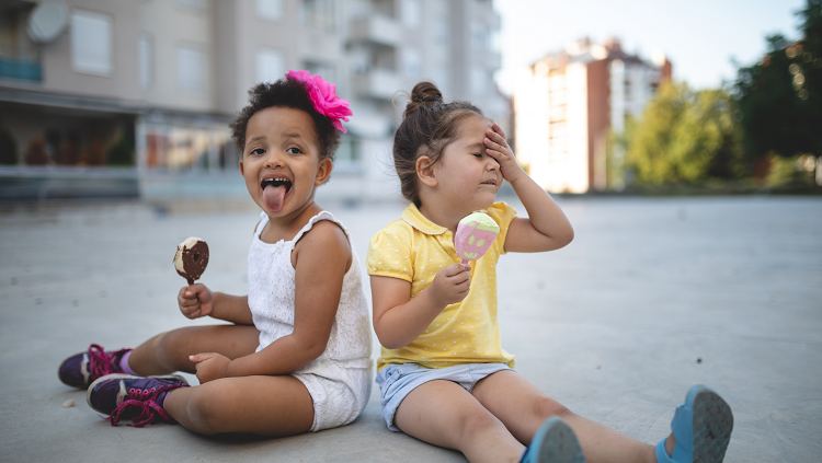 two children eating ice cream